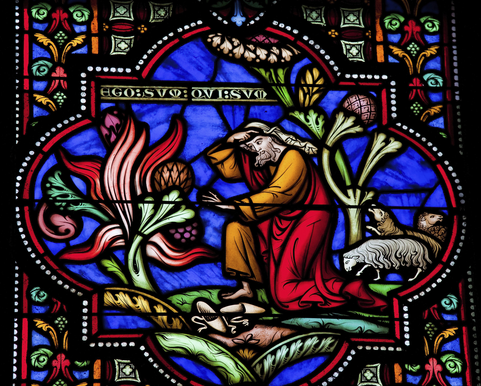 Moses and the burning bush on Mount Horeb. This window is located in the cathedral of Brussels and was created in 1866, no property release is required.