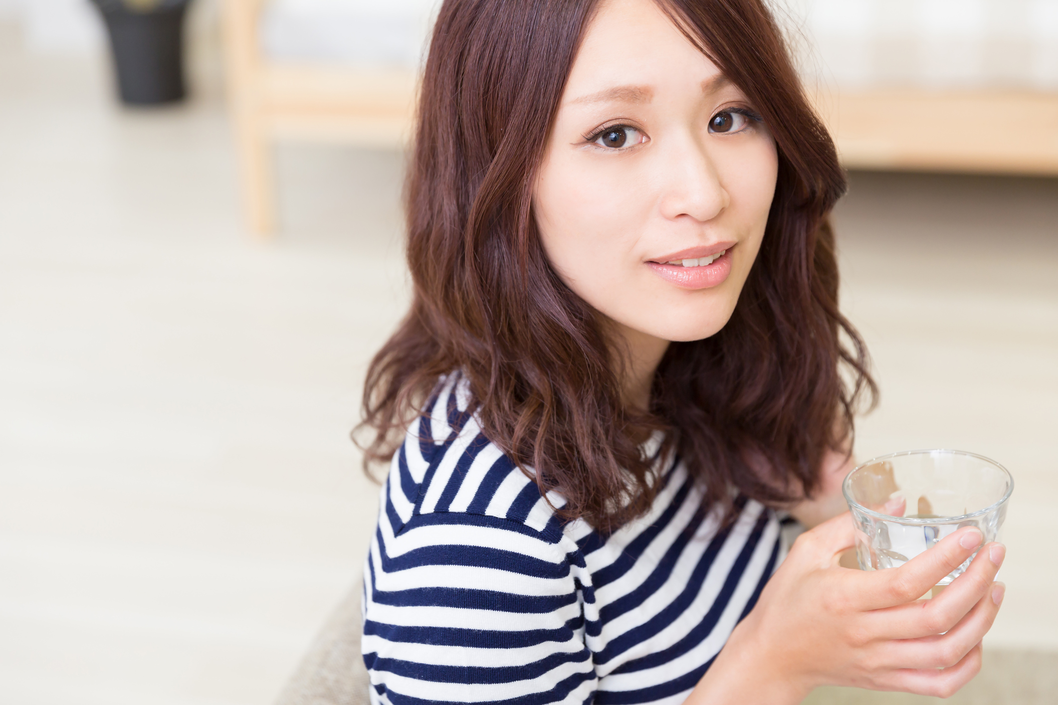 Japanese woman having a glass of water